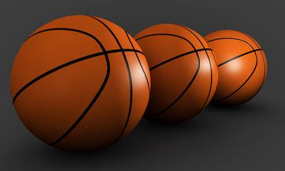 Three basketballs on a gray background