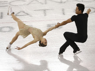Castelli and Tran of the U.S. perform during the pairs short program at Skate Canada International in Lethbridge