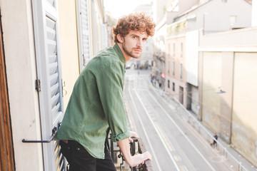 Young beautiful redhead man outdoor