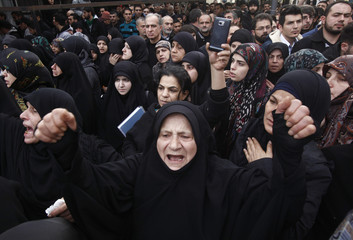 A woman reacts during the funeral of Jihad Moughniyah in Beirut's suburbs