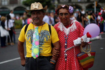 People pose for a photo during an annual Gay Pride Parade in Mexico City