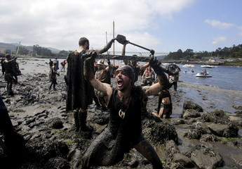 A man dressed up as a Viking shouts during the annual Viking festival of Catoira in north-western Spain