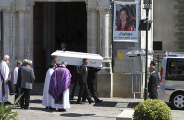 The coffin of Laetitia Perrais leaves the church following the funeral service at the church in La Bernerie-en-Retz, near Nantes