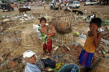 People search for usable items at a junkyard near the Danyingone station in Yangon's suburbs