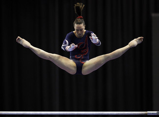 Britain's Tweddle performs in the uneven bars during the senior women's Team Final in the European Artistic Gymnastics Championships in Birmingham