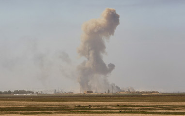 Smoke rise during clashes with Islamic State militants at the town of Tal Ksaiba near the town of al-Alam