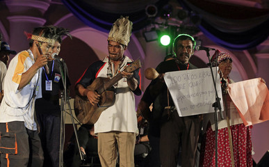 Indigenous Paraguayans sing a song of protest in their native language in Asuncion