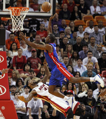 Miami Heat's Haslem is fouled by Detroit Pistons' Stuckey during NBA game in Miami