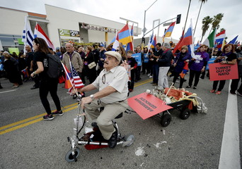 Demonstrators march to commemorate the centenary of a mass killing of Armenians by Ottoman Turks, in Los Angeles