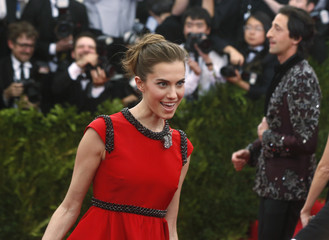 """Allison Williams and Adrien Brody (R, background) arrive at the Metropolitan Museum of Art Costume Institute Gala 2015 celebrating the opening of """"China: Through the Looking Glass,"""" in Manhattan"""