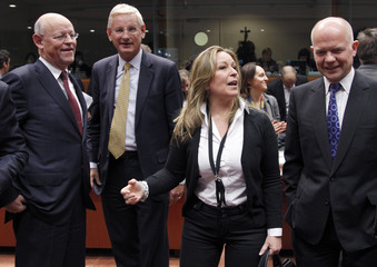 Dutch FM Rosenthal, Swedish counterpart Bildt, Spanish counterpart Jimenez and British Foreign Secretary Hague attend an EU foreign ministers meeting in Brussels