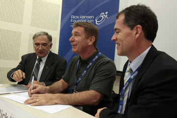 Canadian wheelchair athlete Hansen signs the Rick Hansen Spinal Cord Injury Registry at the Hebrew University in Jerusalem