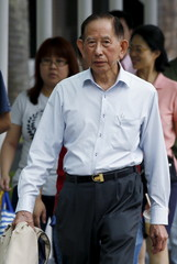 Chinpo Shipping's director Tan Cheng Hoe arrives at the State Court for sentencing in Singapore