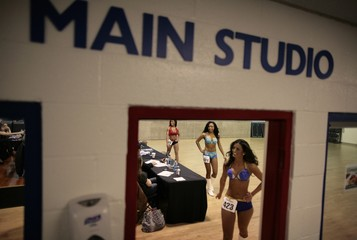 Baltimore Ravens cheerleader hopefuls walk past the judges after performing during tryouts for the Ravens cheerleaders in Baltimore