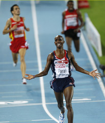 Britain's Farah crosses the finish line to win the men's 5000 metres final at the European Athletics Championships in Barcelona