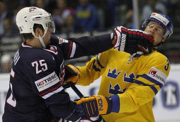 almieri of the U.S. fights with Fernholm of Sweden during their Group C game at the Ice Hockey World Championships in Kosice
