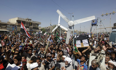 Supporters of Iraqi Shi'ite cleric Moqtada al-Sadr cheer during a demonstration in Baghdad's Sadr city