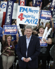 Conservative leader and Canada's PM Harper pauses while speaking during a campaign rally at a community centre in Windsor