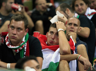 Hungarian soccer supporters react during their team's 2014 World Cup qualifying soccer match against Romania in Bucharest