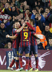 Barcelona's Neymar celebrates his goal with Messi and Alexis against Celta de Vigo during their La Liga soccer match at Nou Camp stadium in Barcelona