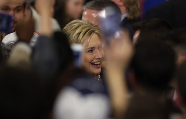 Democratic U.S. presidential candidate Hillary Clinton smiles as she greets supporters after speaking about the primary voting results in Michigan and other states at her campaign rally in Cleveland