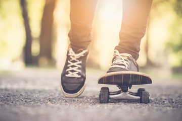 Skater riding a skateboad. Close up on feet