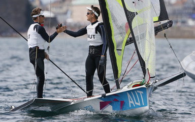 Austria's Nico Delle Karth and Nikolaus Resch react as they cross the finish line in the 49er sailing class during the medal race at the London 2012 Olympic Games