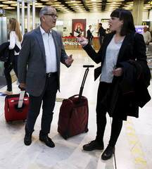 Spanish judge Martin and lawyer Guelbenzu talk upon their arrival at Adolfo Suarez Barajas airport in Madrid