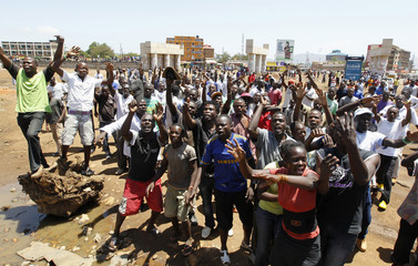 Supporters of Kenyan PM Odinga chant slogans before the announcement of the presidential election results in Kisumu