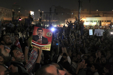 Demonstrators carry a poster of Egyptian President Mohamed Mursi in Cairo