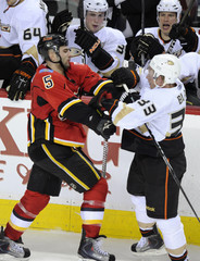 Flames' Giordano and Ducks' Blake mix it up during the second period of their NHL hockey game in Calgary