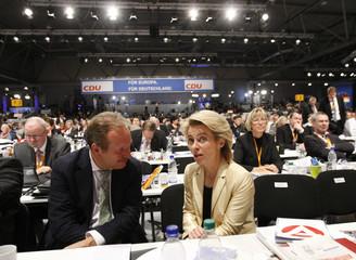 German labour minister von der Leyen chats with head of German services industry union Verdi Bsirske during CDU party meeting in Leipzig