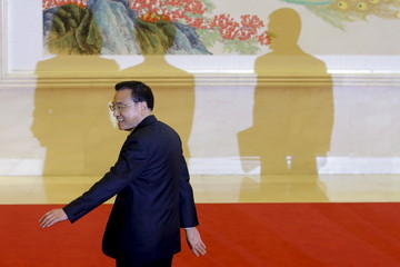 China's Premier Li Keqiang leaves after a news conference following the closing ceremony of China's National People's Congress at the Great Hall of the People in Beijing
