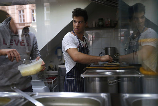 A cook makes soup at a small eatery in central Budapest