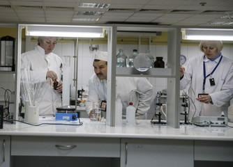 Employees work in a lab at a plant for processing liquid radioactive waste at the Chernobyl nuclear power plant