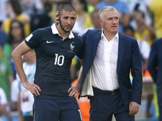 France's Benzema reacts with team coach Deschamps to their loss at the end of their 2014 World Cup quarter-finals against Germany at the Maracana stadium in Rio de Janeiro