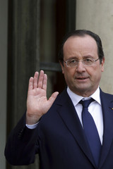 French President Francois Hollande reacts as he accompanies a guest at the Elysee Palace in Paris