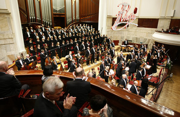 The audience applaud the Symphonic Orchestra and Choir of the National Philharmonic during the inauguration concert of the 16th International Fryderyk Chopin Piano Competition at Warsaw Philharmonic Concert Hall