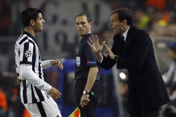 Morata of Juventus listens to coach Allegri during their Champions League round of 16 second leg soccer match against Borussia Dortmund in Dortmund