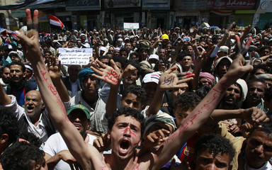 Anti-government protesters shouts slogans during a rally to demand the ouster of Yemen's President Ali Abdullah Saleh outside Sanaa University
