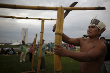 Brazilian Indians from several ethnic groups build huts while attending the Terra Livre Camp in Brasilia