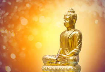 Lord Budha Statue Gold bokeh background