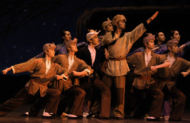 Dancers perform at The White-Haired Girl ballet in the Shanghai City Theatre