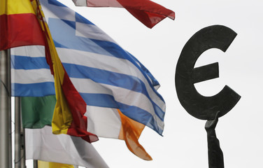 Greek and others European national flags flutter near an euro symbol outside the EU Parliament in Brussels
