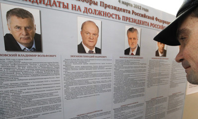 A man looks at the list of presidential candidates at a polling station in St.Petersburg
