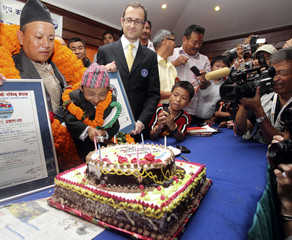 Khagendra Thapa cuts a cake to celebrate his 18th birthday at a function in Pokhara