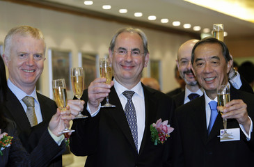 British Consul-General Seaton, Prudential Chairman McGrath and Hong Kong Exchanges & Clearing Limited Chairman Arculli toast during the listing of Prudential at the Hong Kong Stock Exchange