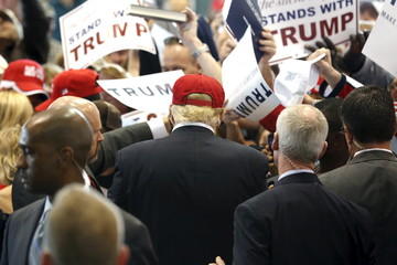 Trump signs autographs for supporters after a rally in Harrington, Delaware