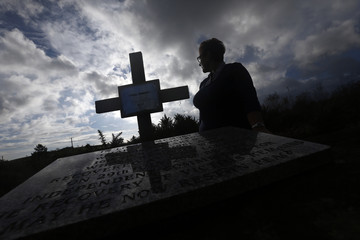 Anna McShane stands at the location where her father Charlie Armstrong's remains were discovered in County Monaghan