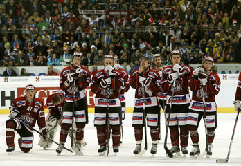 Team of Dinamo Riga reacts after losing their final game against HC Davos at the Spengler Cup ice hockey tournament in Davos